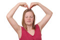 Heart gesture portrait of a teenage girl doing a with her hands on white background Royalty Free Stock Images