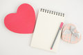 Heart gift box and notebook on white background note book pen Royalty Free Stock Photos