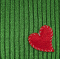 Heart on green knitted wool background Royalty Free Stock Photography