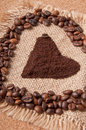 Heart of ground coffee and coffee beans Royalty Free Stock Image