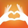 Heart in hand silhouette