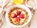 Heart healthy breakfast a consisting of vanilla greek yogurt topped with granola sliced bananas and strawberries shaped like Stock Photography
