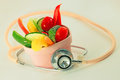 Heart healthy eating raw vegetables heart shaped bowl stethoscope Stock Photo