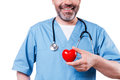 Heart in his hand close up of mature cardiology surgeon holding shape toy and smiling while standing isolated on white Royalty Free Stock Photo
