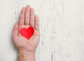 Heart in human hand white wood background retro tinted Royalty Free Stock Photo