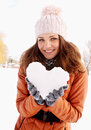 Heart of ice in the hands of woman holds a Stock Image