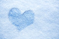 Heart from ice on snow background Stock Images