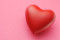 Heart image of red on pink paper Royalty Free Stock Images