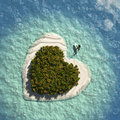 Heart island with sail boat Stock Photography