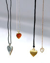 Heart jewelry necklaces on ribbons and chains romantic jewlery Royalty Free Stock Images