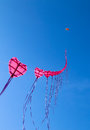 Heart kites flying with blue sky background Stock Images