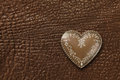 Heart on leather background Stock Photo