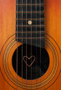 A heart lies on strings the guitar Royalty Free Stock Photo