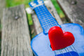Heart on a lonely guitar. Royalty Free Stock Photo
