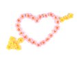 Heart made of artificial flowers. Royalty Free Stock Photo