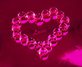 Heart made ​​of pink crystal beads Stock Image