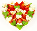 Heart made ​​of tomatoes mozzarella and basil Stock Images