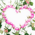 Floral frame made of pink roses and buds on white background. Valentines day. Flat lay, Top view