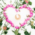 Heart made of pink roses on white background. Flat lay, top view. Valentine`s background. Pattern made of flowers.