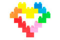Heart made from plastic toy blocks on white background Stock Image