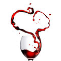 Heart made of pouring red wine in glass Royalty Free Stock Photo