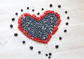 Heart made with red currant berries and blueberries Royalty Free Stock Photo