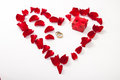 Heart made of red rose petals and golden ring Royalty Free Stock Photos