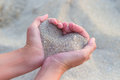 Heart made of sand holding in hands in shape Stock Photography