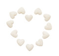 Heart made of white heart shape tablets isolated on white Royalty Free Stock Photo