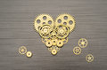 Heart mechanism made out of gears and cogs Stock Photos
