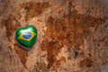 Heart with national flag of brazil on a vintage world map crack paper background. Royalty Free Stock Photo