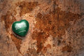 Heart with national flag of saudi arabia on a vintage world map crack paper background. Royalty Free Stock Photo