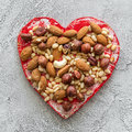 Heart with nuts on a gray background