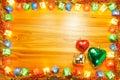 Heart ornament in christmas light frame on golden wooden backgro Royalty Free Stock Photo