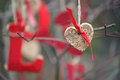 Heart ornament with red ribbon hanging on a tree Stock Image