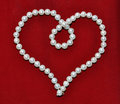 Heart from pearls on velvet Royalty Free Stock Photos
