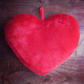 Heart pillow on wood Stock Image