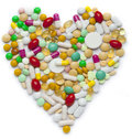 Heart of pills and capsules isolated on white background Stock Photo