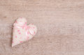 Heart with pink ribbon of bow and free space on a wooden board Royalty Free Stock Images