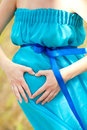 Heart on the pregnant belly Royalty Free Stock Photo