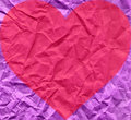 Heart on purple wrinkled paper Royalty Free Stock Images