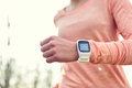 Heart rate monitor smart watch for sport with athlete wearing runner using sports smartwatch on running workout Stock Images