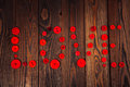 Heart of red buttons, the concept of Valentine's Day, wooden bac