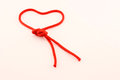 Heart of red cord symbol for saint valentine day with a drawn with a piece Royalty Free Stock Photos