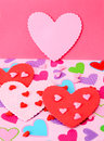Heart in red and pink hearts on a multicolored back ground Stock Image