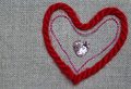 Heart of red and pink thread shiny buttons in the shape Stock Photo