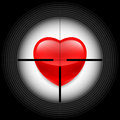 Heart in rifle sight with a red glass as a target Royalty Free Stock Image