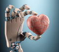 Heart of a robot hand holding metal clipping path included Royalty Free Stock Images