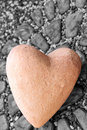 Heart rock black and white image with large colorful the words i love you in red Stock Photo