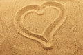 Heart in the sand drawn conceptual image for love or valentines day Royalty Free Stock Photo